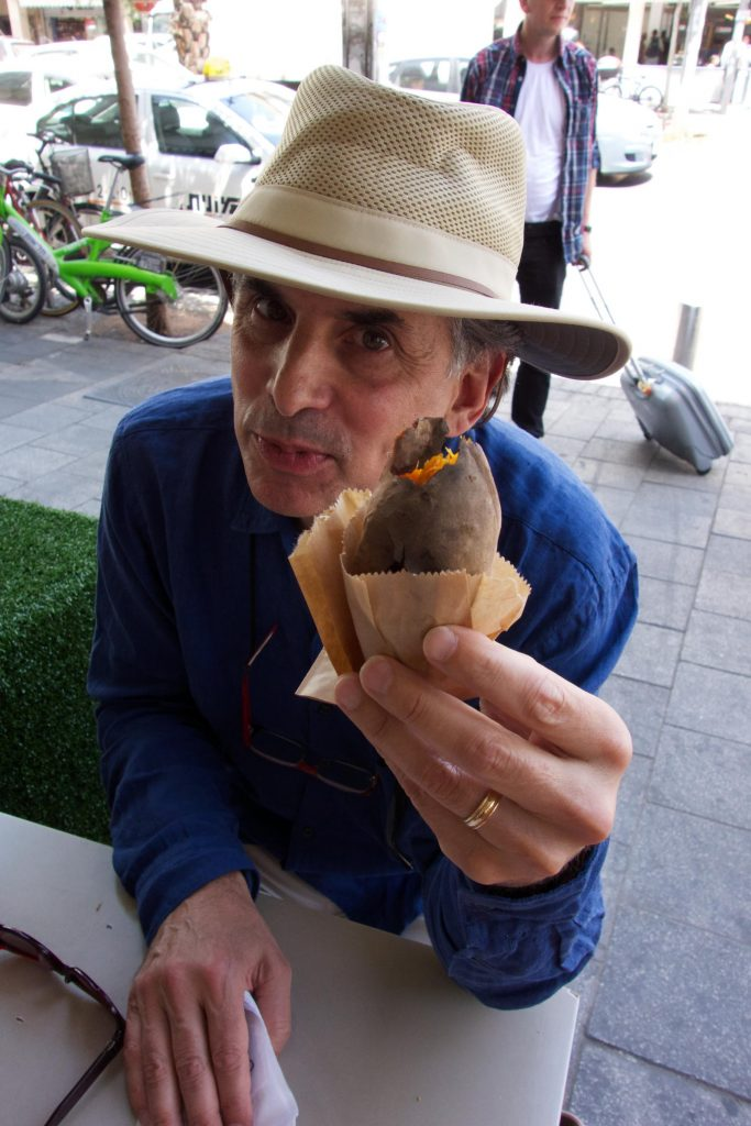 Director Roger Sherman enjoying a baked sweet potato on the street