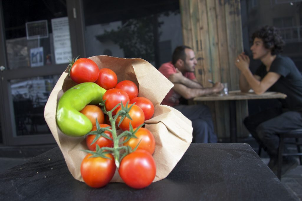 Red cherry tomatoes served on vine at a Tel Aviv restaurant